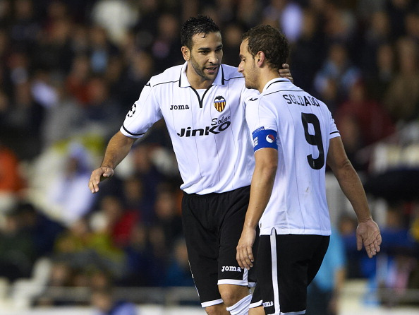 VALENCIA, SPAIN - NOVEMBER 07:  Roberto Soldado (R) of Valencia celebrates with his team-mate Adil Rami after scoring his team's second goal during the UEFA Champions League group F match between Valencia CF and FC BATE Borisov at Estadi de Mestalla on November 7, 2012 in Valencia, Spain. Valencia won 4-2.  (Photo by Manuel Queimadelos Alonso/Getty Images)
