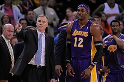 December 22, 2012; Oakland, CA, USA; Los Angeles Lakers head coach Mike D'Antoni (left) and center Dwight Howard (12) react after Howard fouled out during the overtime quarter against the Golden State Warriors at ORACLE Arena. The Lakers defeated the Warriors 118-115 in overtime. Mandatory Credit: Kyle Terada-USA TODAY Sports