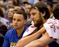 Feb 19, 2013; Salt Lake City, UT, USA; Golden State Warriors point guard Stephen Curry (left) and center Andrew Bogut (right) watch the action from the bench during the first half against the Utah Jazz at EnergySolutions Arena. Mandatory Credit: Russ Isabella-USA TODAY Sports