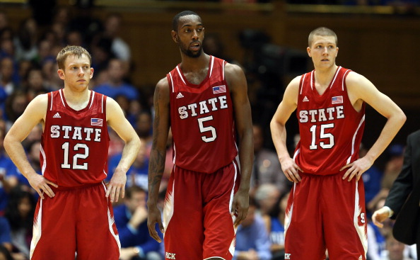 DURHAM, NC - FEBRUARY 07:  Teammates Tyler Lewis #12, C.J. Leslie #5 and Scott Wood #15 of the North Carolina State Wolfpack react as they watch on against the Duke Blue Devils during their game at Cameron Indoor Stadium on February 7, 2013 in Durham, North Carolina.  (Photo by Streeter Lecka/Getty Images)