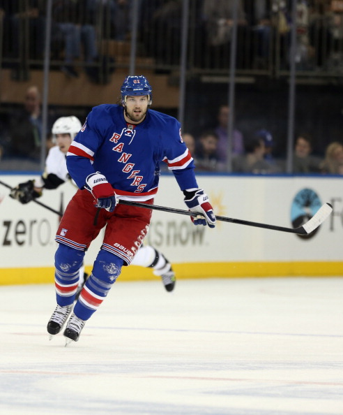 NEW YORK, NY - JANUARY 20:  Rick Nash #61 of the New York Rangers skates against the Pittsburgh Penguins at Madison Square Garden on January 20, 2013 in New York City. The Penguins defeated the Rangers 6-3.  (Photo by Bruce Bennett/Getty Images)
