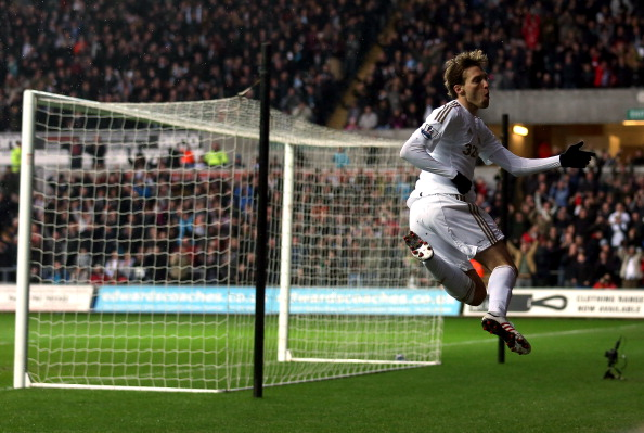 SWANSEA, WALES - FEBRUARY 09:  Michu of Swansea celebrates scoring the opening goal during the Premier League match between Swansea City and Queens Park Rangers at Liberty Stadium on February 9, 2013 in Swansea, Wales.  (Photo by Warren Little/Getty Images)