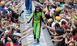 Feb 24, 2013; Daytona Beach, FL, USA; NASCAR Sprint Cup Series driver Danica Patrick greets fans as she is introduced before the 2013 Daytona 500 at Daytona International Speedway. Mandatory Credit: Jerry Lai-USA TODAY Sports