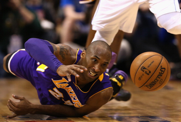 DALLAS, TX - FEBRUARY 24:  Kobe Bryant #24 of the Los Angeles Lakers falls after fouled by O.J. Mayo #32 of the Dallas Mavericks at American Airlines Center on February 24, 2013 in Dallas, Texas.   NOTE TO USER: User expressly acknowledges and agrees that, by downloading and or using this photograph, User is consenting to the terms and conditions of the Getty Images License Agreement.  (Photo by Ronald Martinez/Getty Images)