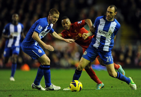 LIVERPOOL, ENGLAND - NOVEMBER 17:  Raheem Sterling of Liverpool in action with Ivan Ramis (R) and James McCarthy of Wigan Athletic during the Barclays Premier League match between Liverpool and Wigan Athletic at Anfield on November 17, 2012 in Liverpool, England.  (Photo by Chris Brunskill/Getty Images)