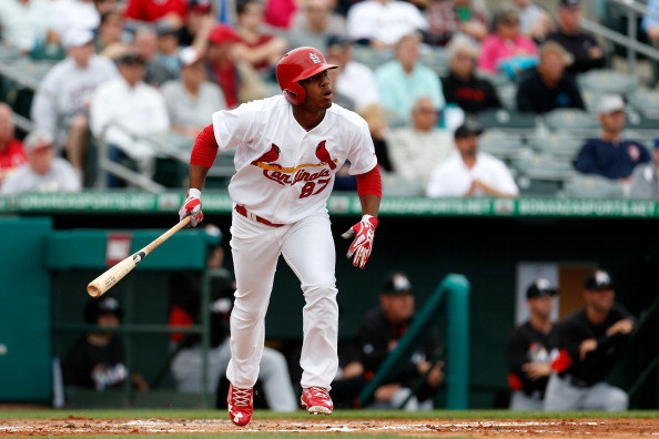 JUPITER, FL - FEBRUARY 28: Oscar Taveras #87 of the St. Louis Cardinals hits a grand slam home run in the first inning against the Miami Marlins at the Roger Dean Stadium on February 28, 2013 in Jupiter, Florida.  (Photo by Chris Trotman/Getty Images)