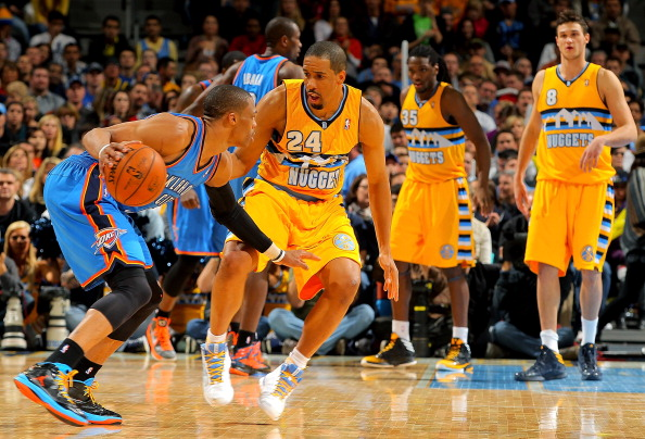 DENVER, CO - JANUARY 20:  Russell Westbrook #0 of the Oklahoma City Thunder controls the ball against Andre Miller #24 of the Denver Nuggets at the Pepsi Center on January 20, 2013 in Denver, Colorado. The Nuggets defeated the Thunder 121-118 in overtime. NOTE TO USER: User expressly acknowledges and agrees that, by downloading and or using this photograph, User is consenting to the terms and conditions of the Getty Images License Agreement.  (Photo by Doug Pensinger/Getty Images)