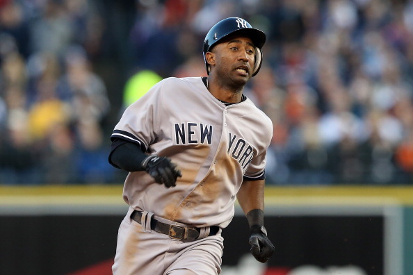 DETROIT, MI - OCTOBER 18:  Eduardo Nunez #26 of the New York Yankees runs towards third  base as he scores on a RBI double by Nick Swisher #33 in the top of the sixth inning against the Detroit Tigers during game four of the American League Championship Series at Comerica Park on October 18, 2012 in Detroit, Michigan.  (Photo by Leon Halip/Getty Images)