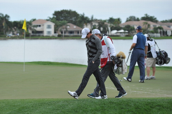 PALM BEACH GARDENS, FL - MARCH 01:  World number one and defending champion, Rory McIlroy of Northern Ireland walks off the course on the 18th hole, his nineth during the second round of the Honda Classic on March 1, 2013 in Palm Beach Gardens, Florida.  (Photo by Stuart Franklin/Getty Images)