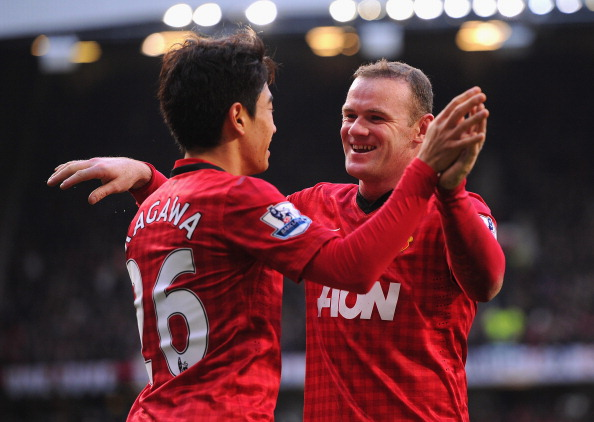 MANCHESTER, ENGLAND - MARCH 02:  Shinji Kagawa of Manchester United celebrates scoring to make it 3-0 with team mate and claim a hat-trick with team mate Wayne Rooney during the Barclays Premier League match between Manchester United and Norwich City at Old Trafford on March 2, 2013 in Manchester, England.  (Photo by Michael Regan/Getty Images)