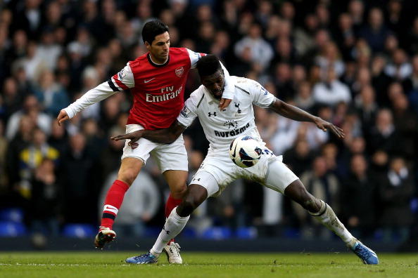 LONDON, ENGLAND - MARCH 03:  Emmanuel Abebayor of Spurs is challenged by Mikel Arteta of Arsenal during the Barclays Premier League match between Tottenham Hotspur and Arsenal FC at White Hart Lane on March 3, 2013 in London, England.  (Photo by Paul Gilham/Getty Images)