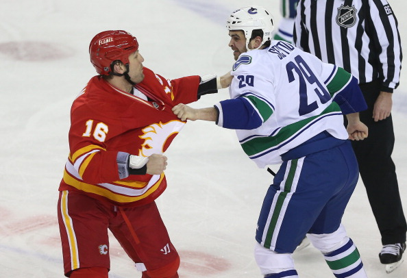 CALGARY, CANADA - MARCH 3: Brian McGrattan #16 of the Calgary Flames fights Tom Sestito #29 of the Vancouver Canucks during their NHL game at the Scotiabank Saddledome on March 3, 2013 in Calgary, Alberta, Canada. (Photo by Tom Szczerbowski/Getty Images)