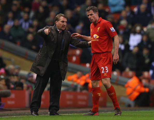 LIVERPOOL, ENGLAND - FEBRUARY 11:  Liverpool Manager Brendan Rodgers gestures to Jamie Carragher of Liverpool during the Barclays Premier League match between Liverpool and West Bromwich Albion at Anfield on February 11, 2013 in Liverpool, England.  (Photo by Alex Livesey/Getty Images)