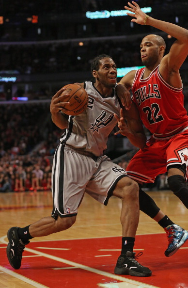 CHICAGO, IL - FEBRUARY 11:  Kawhi Leonard #2 of the San Antonio Spurs drives against Taj Gibson #22 of the Chicago Bulls at the United Center on February 11, 2013 in Chicago, Illinois. The Spurs defeated the Bulls 103-89. NOTE TO USER: User expressly acknowledges and agrees that, by downloading and or using this photograph, User is consenting to the terms and conditions of the Getty Images License Agreement.  (Photo by Jonathan Daniel/Getty Images)