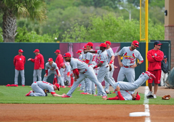 KISSIMMEE, FL - MARCH 1: Members of the St. Louis Cardinals warm up before a spring training game against the Houston Astros at Osceola County Stadium on March 1, 2013 in Kissimmee, Florida. (Photo by Scott Cunningham/Getty Images)