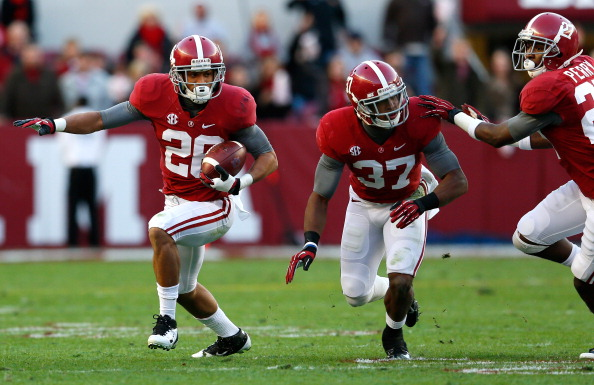 TUSCALOOSA, AL - NOVEMBER 24:  Dee Milliner #28 of the Alabama Crimson Tide returns a fumble by Tre Mason #21 of the Auburn Tigers at Bryant-Denny Stadium on November 24, 2012 in Tuscaloosa, Alabama.  (Photo by Kevin C. Cox/Getty Images)