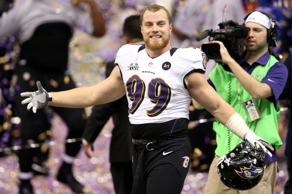 NEW ORLEANS, LA - FEBRUARY 03:  Paul Kruger #99 of the Baltimore Ravens celebrates after the Ravens won 34-31 against the San Francisco 49ers during Super Bowl XLVII at the Mercedes-Benz Superdome on February 3, 2013 in New Orleans, Louisiana.  (Photo by Ronald Martinez/Getty Images)