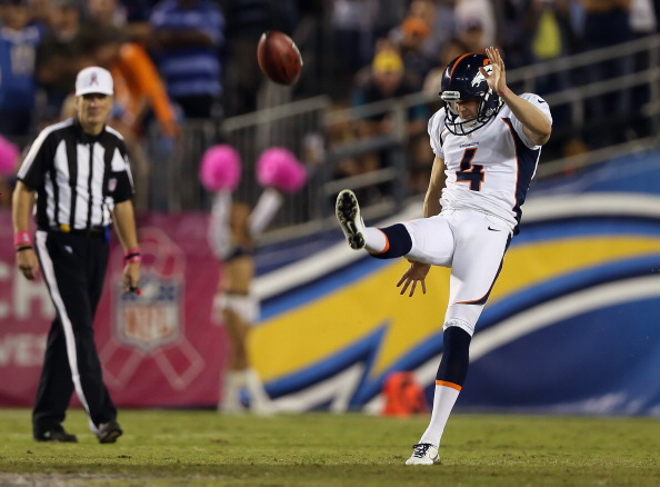 SAN DIEGO, CA - OCTOBER 15:  Punter Britton Colquitt #4 of the Denver Broncos punts the ball against the San Diego Chargers at Qualcomm Stadium on October 15, 2012 in San Diego, California.  (Photo by Jeff Gross/Getty Images)