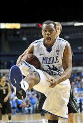 Dec 21, 2012; Murfreesboro, TN, USA; Middle Tennessee Blue Raiders guard Marcos Knight (14) reacts after pulling down a rebound against the Vanderbilt Commodores during the second half at Bridgestone Arena. Middle Tennessee defeated Vanderbilt 56-52. Mandatory Credit: Jim Brown-USA TODAY Sports