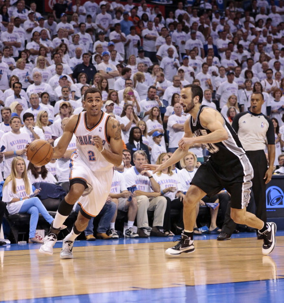 OKLAHOMA CITY, OK - JUNE 06:  Thabo Sefolosha #2 of the Oklahoma City Thunder drives on Manu Ginobili #20 of the San Antonio Spurs in Game Six of the Western Conference Finals in the 2012 NBA Playoffs on June 6, 2012 at the Chesapeake Energy Arena in Oklahoma City, Oklahoma. The Thunder beat the Spurs 107-99.  NOTE TO USER: User expressly acknowledges and agrees that, by downloading and or using the photograph, User is consenting to the terms and conditions of the Getty Images License Agreement. (Photo by Brett Deering/Getty Images)
