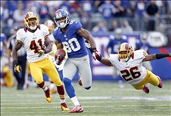 Oct 21, 2012; East Rutherford, NJ, USA; New York Giants wide receiver Victor Cruz (80) beats Washington Redskins cornerback Josh Wilson (26) for a 77-yard touchdown catch late in the second half at MetLife Stadium. Mandatory Credit: Andrew Mills/THE STAR-LEDGER via USA TODAY Sports