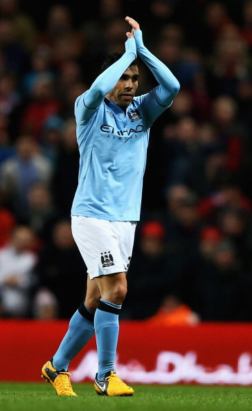 MANCHESTER, ENGLAND - MARCH 09:  Carlos Tevez of Manchester City applauds the home fans, after he was substituted during the FA Cup sponsored by Budweiser Sixth Round match between Manchester City and Barnsley at Etihad Stadium on March 9, 2013 in Manchester, England.  (Photo by Matthew Lewis/Getty Images)