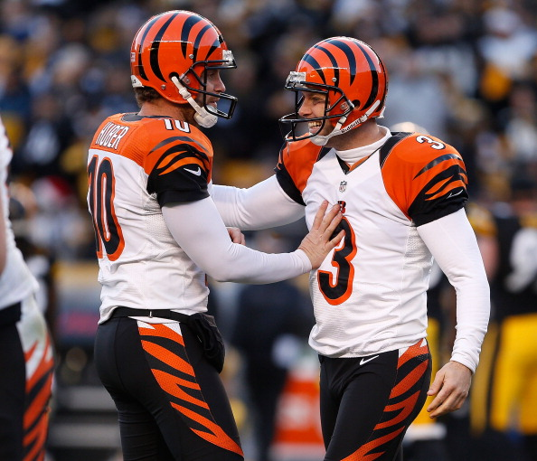 PITTSBURGH, PA - DECEMBER 23:  Josh Brown #3 of the Cincinnati Bengals reacts with Kevin Huber #10 after a late fourth quarter field goal to beat the Pittsburgh Steelers 13-10 at Heinz Field on December 23, 2012 in Pittsburgh, Pennsylvania. (Photo by Gregory Shamus/Getty Images)