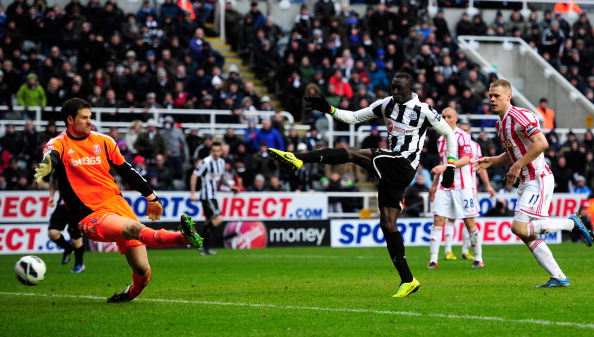 NEWCASTLE UPON TYNE, ENGLAND - MARCH 10:  Stoke keeper Asmir Bergovic is beaten by Newcastle forward Papiss Cisse for the winning goal during the Barclays Premier League match between Newcastle United and Stoke City at St James' Park on March 10, 2013 in Newcastle upon Tyne, England.  (Photo by Stu Forster/Getty Images)