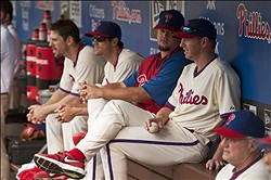 May 15, 2012; Philadelphia, PA, USA; Philadelphia Phillies pitchers (R to L)  Roy Halladay (34) Joe Blanton (56)  Cole Hamels (35) and Cliff Lee (33) watch the game from the dugout during the ninth inning against the Houston Astros at Citizens Bank Park. The Phillies defeated the Astros 4-3 in 10 innings. Mandatory Credit: Howard Smith-USA TODAY Sports