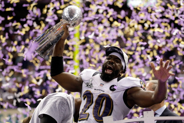 NEW ORLEANS, LA - FEBRUARY 03:  Ed Reed #20 of the Baltimore Ravens celebrates with the VInce Lombardi trophy after the Ravens won 34-31 against the San Francisco 49ers during Super Bowl XLVII at the Mercedes-Benz Superdome on February 3, 2013 in New Orleans, Louisiana.  (Photo by Ezra Shaw/Getty Images)