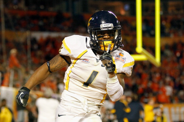 MIAMI GARDENS, FL - JANUARY 04:  Tavon Austin #1 of the West Virginia Mountaineers celebrates after he scored an 8-yard rushing touchdown in the first quarter against the Clemson Tigers during the Discover Orange Bowl at Sun Life Stadium on January 4, 2012 in Miami Gardens, Florida.  (Photo by Streeter Lecka/Getty Images)