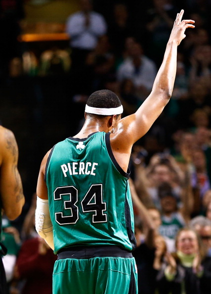 BOSTON, MA - MARCH 13: Paul Pierce #34 of the Boston Celtics acknowledges the crowd after passing Hall of Famer Charles Barkley on the all-time career points list during the game against the Toronto Raptors on March 13, 2013 at TD Garden in Boston, Massachusetts. NOTE TO USER: User expressly acknowledges and agrees that, by downloading and or using this photograph, User is consenting to the terms and conditions of the Getty Images License Agreement. (Photo by Jared Wickerham/Getty Images)