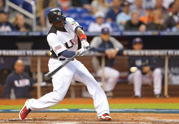 MIAMI, FL - MARCH 15:  Brandon Phillips #4 of the United States hits during a World Baseball Classic second round game against Puerto Rico at Marlins Park on March 15, 2013 in Miami, Florida.  (Photo by Mike Ehrmann/Getty Images)