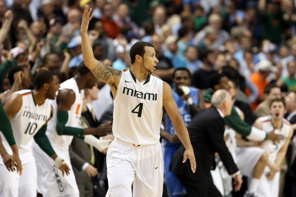GREENSBORO, NC - MARCH 17:  Trey McKinney Jones #4 of the Miami (Fl) Hurricanes reacts in the second half against the North Carolina Tar Heels during the final of the Men's ACC Basketball Tournament at Greensboro Coliseum on March 17, 2013 in Greensboro, North Carolina.  (Photo by Streeter Lecka/Getty Images)