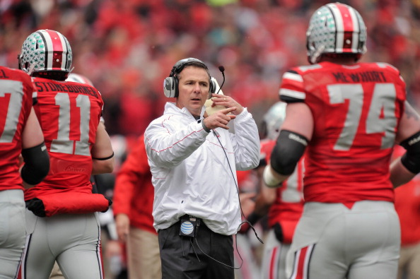 COLUMBUS, OH - NOVEMBER 24: Head Coach Urban Meyer of the Ohio State Buckeyes gives his team instructions during a game against the Michigan Wolverines at Ohio Stadium on November 24, 2012 in Columbus, Ohio. (Photo by Jamie Sabau/Getty Images)