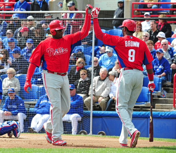 DUNEDIN, FL - MARCH 2: Ryan Howard #6 of the Philadelphia Phillies is congratulated by Domonic Brown #9 after hitting a first inning home run during a spring training game against the Toronto Blue Jays at Florida Auto Exchange Stadium on March 2, 2013 in Dunedin, Florida. (Photo by Scott Cunningham/Getty Images)