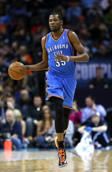 CHARLOTTE, NC - MARCH 08:  Kevin Durant #35 of the Oklahoma City Thunder dribbles down the court during their game against the Charlotte Bobcats at Time Warner Cable Arena on March 8, 2013 in Charlotte, North Carolina. NOTE TO USER: User expressly acknowledges and agrees that, by downloading and or using this photograph, User is consenting to the terms and conditions of the Getty Images License Agreement.  (Photo by Streeter Lecka/Getty Images)