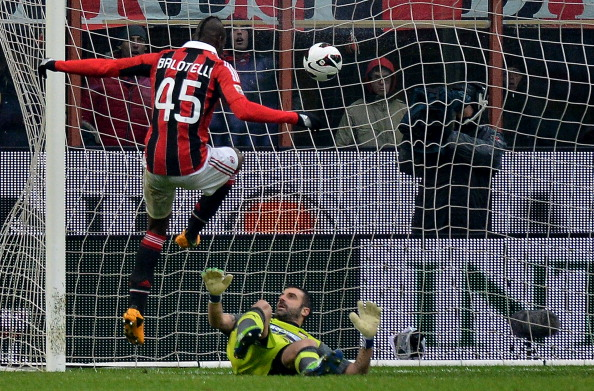 MILAN, ITALY - MARCH 17:  Mario Balotelli of Milan scores his second goal during the Serie A match between AC Milan and US Citta di Palermo at San Siro Stadium on March 17, 2013 in Milan, Italy.  (Photo by Tullio M. Puglia/Getty Images)