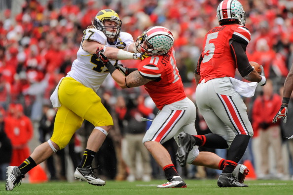 COLUMBUS, OH - NOVEMBER 24: Jake Ryan #47 of the Michigan Wolverines fights through a block from Jake Stoneburner #11 of the Ohio State Buckeyes to chase quarterback Braxton Miller #5 of the Ohio State Buckeyes at Ohio Stadium on November 24, 2012 in Columbus, Ohio. (Photo by Jamie Sabau/Getty Images)