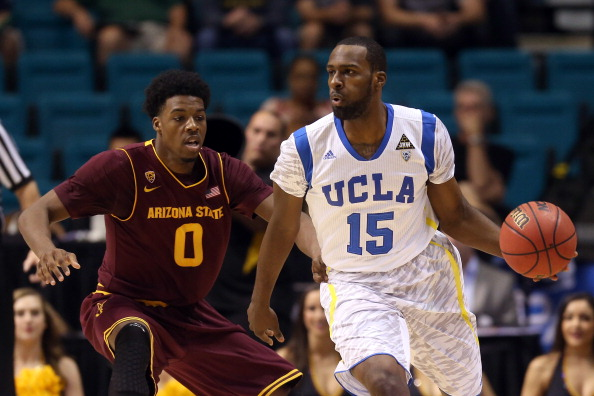LAS VEGAS, NV - MARCH 14:  Shabazz Muhammad #15 of the UCLA Bruins drives on Carrick Felix #0 of the Arizona State Sun Devils in the first half during the quarterfinals of the Pac-12 tournament at the MGM Grand Garden Arena on March 14, 2013 in Las Vegas, Nevada.  (Photo by Jeff Gross/Getty Images)
