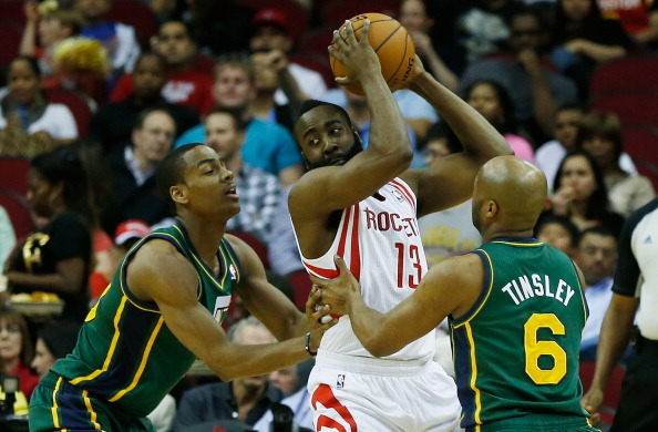 HOUSTON, TX - MARCH 20:  James Harden #13 of the Houston Rockets looks to pass over Alec Burks #10 and Jamaal Tinsley #6 of the Utah Jazz at Toyota Center on March 20, 2013 in Houston, Texas. NOTE TO USER: User expressly acknowledges and agrees that, by downloading and or using this photograph, User is consenting to the terms and conditions of the Getty Images License Agreement.  (Photo by Scott Halleran/Getty Images)