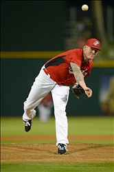 Mar 12, 2013; Goodyear, AZ, USA; Cincinnati Reds starting pitcher Mat Latos (55) pitches during the first inning against the Los Angeles Dodgers at Goodyear Ballpark. Mandatory Credit: Jake Roth-USA TODAY Sports