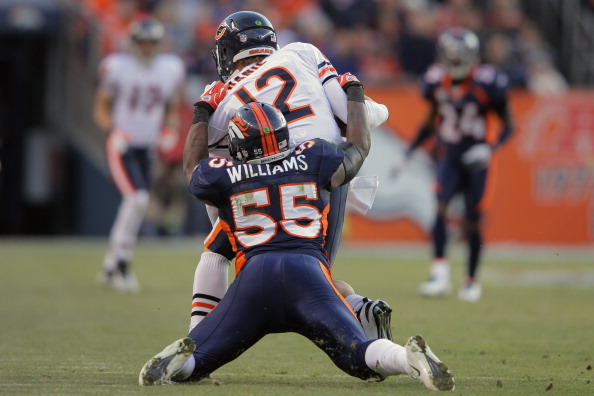 DENVER, CO - DECEMBER 11:  Quarterback Caleb Hanie #12 of the Chicago Bears is tackled by linebacker D.J. Williams #55 of the Denver Broncos at Sports Authority Field at Mile High on December 11, 2011 in Denver, Colorado. The Brocnos defeated the Bears 13-10 in overtime.  (Photo by Doug Pensinger/Getty Images)