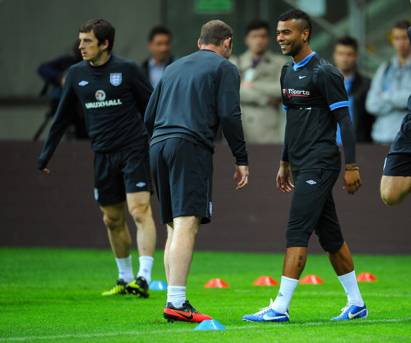 WARSAW, POLAND - OCTOBER 15: Ashley Cole and Leighton Baines look on during the England training session ahead of their FIFA World Cup qualifier against Poland at the National Stadium on October 15, 2012 in Warsaw, Poland.  (Photo by Michael Regan/Getty Images)