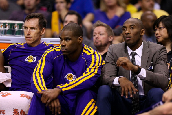 PHOENIX, AZ - MARCH 18:  (L-R) Steve Nash #10, Antawn Jamison #4 and Kobe Bryant #24 of the Los Angeles Lakers react on the bench late in the fourth quarter of the NBA game against the Phoenix Suns at US Airways Center on March 18, 2013 in Phoenix, Arizona.  The Suns defeated the Lakers 99-76. NOTE TO USER: User expressly acknowledges and agrees that, by downloading and or using this photograph, User is consenting to the terms and conditions of the Getty Images License Agreement.  (Photo by Christian Petersen/Getty Images)