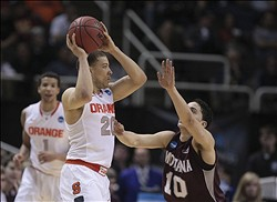 Mar 21, 2013; San Jose, CA, USA; Syracuse Orange guard Brandon Triche (20) controls the ball against Montana Grizzlies guard Jordan Gregory (10) during the first half of the second round of the 2013 NCAA tournament at HP Pavilion. Mandatory Credit: Kelley L Cox-USA TODAY Sports