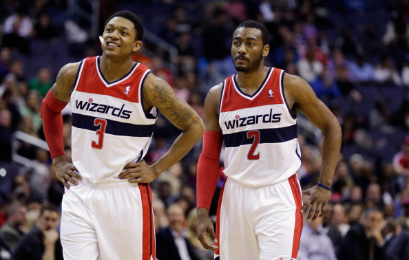 WASHINGTON, DC - MARCH 16: Bradley Beal #3 and and John Wall #2 of the Washington Wizards talk during a free throw in the first half against the Phoenix Suns at Verizon Center on March 16, 2013 in Washington, DC. NOTE TO USER: User expressly acknowledges and agrees that, by downloading and or using this photograph, User is consenting to the terms and conditions of the Getty Images License Agreement.  (Photo by Rob Carr/Getty Images)