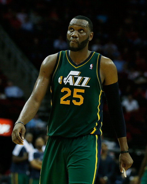 HOUSTON, TX - MARCH 20:  Al Jefferson #25 of the Utah Jazz walks across the court during the game against the Utah Jazz at Toyota Center on March 20, 2013 in Houston, Texas. NOTE TO USER: User expressly acknowledges and agrees that, by downloading and or using this photograph, User is consenting to the terms and conditions of the Getty Images License Agreement.  (Photo by Scott Halleran/Getty Images)