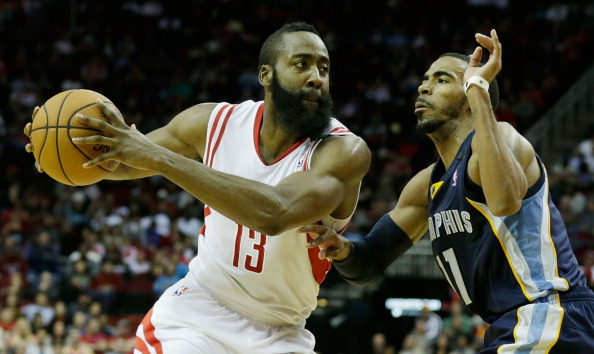 HOUSTON, TX - DECEMBER 22:  James Harden #13 of the Houston Rockets drives against Mike Conley #11 of the Memphis Grizzlies at the Toyota Center on December 22, 2012 in Houston, Texas. NOTE TO USER: User expressly acknowledges and agrees that, by downloading and or using this photograph, User is consenting to the terms and conditions of the Getty Images License Agreement.  (Photo by Scott Halleran/Getty Images)
