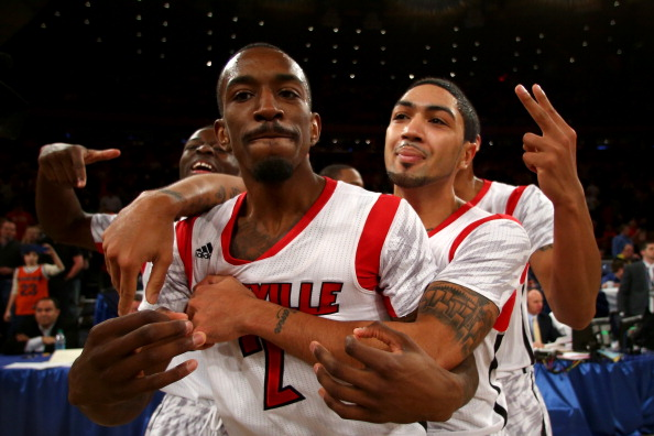 NEW YORK, NY - MARCH 16:  (L-R) Russ Smith #2 and Peyton Siva #3 of the Louisville Cardinals celebrate after they won 78-61 against the Syracuse Orange during the final of the Big East Men's Basketball Tournament at Madison Square Garden on March 16, 2013 in New York City.  (Photo by Elsa/Getty Images)